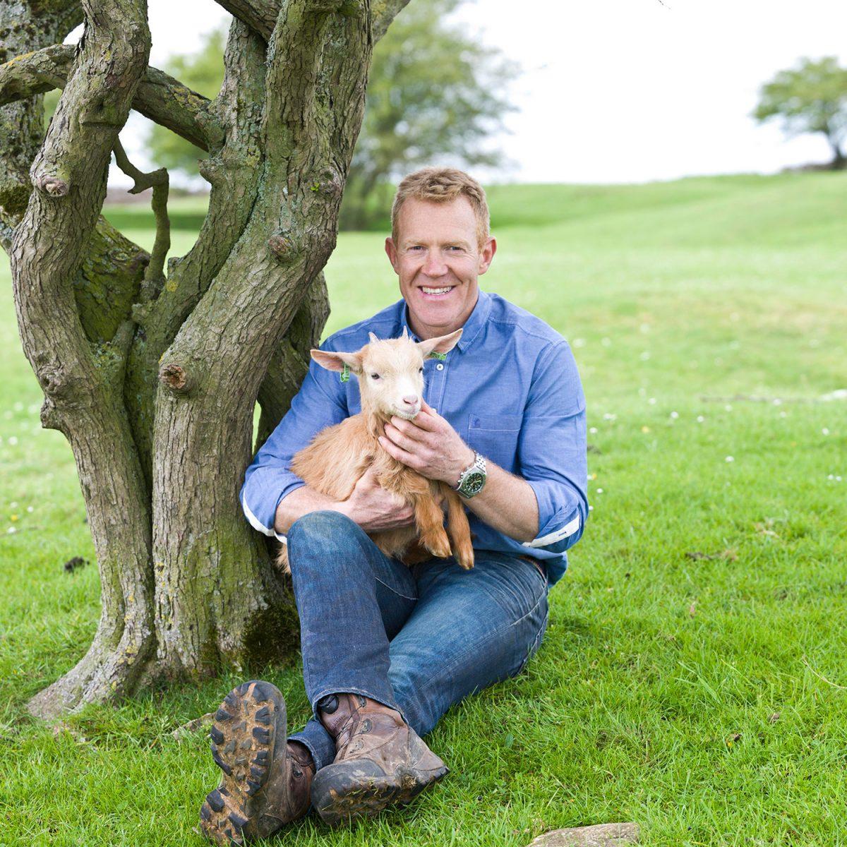 Adam Henderson holding a lamb